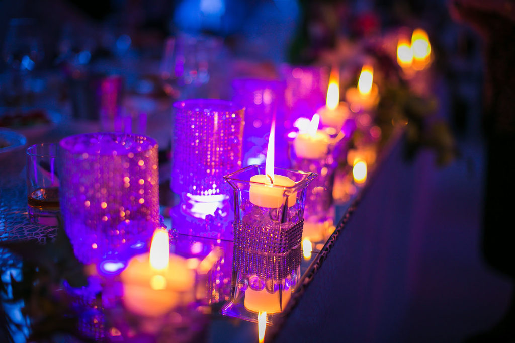 Purple candlelight glow at wedding reception