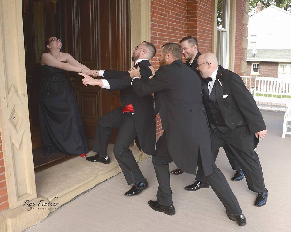 Groom and wedding party having fun before wedding
