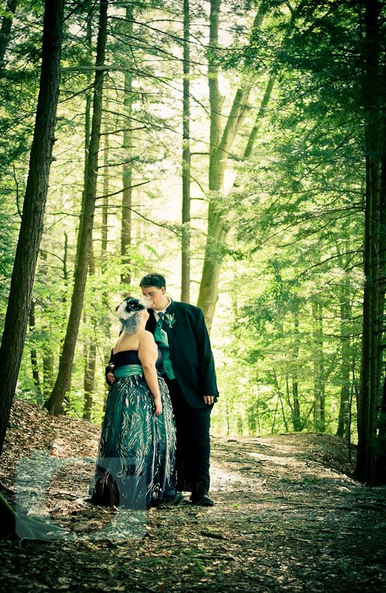 bride and groom in woods cleveland wedding planner