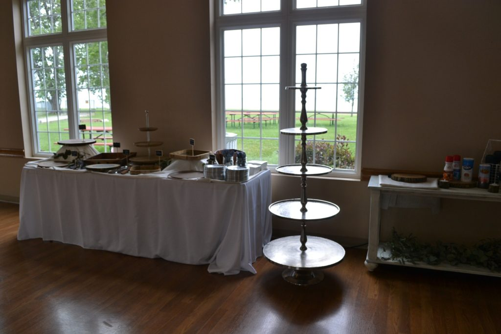 Dessert Table and Cupcake stand being set up by Cleveland Wedding Planner