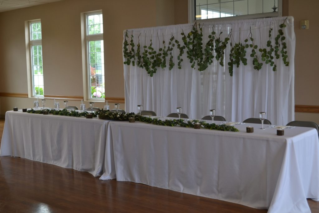 Head Table with Greenery