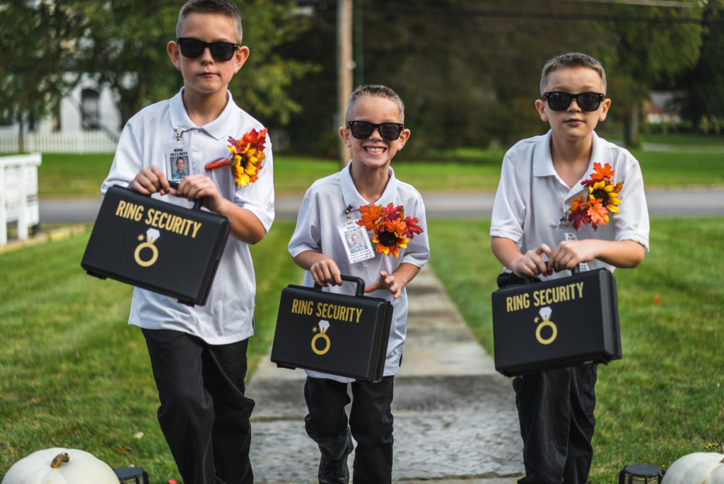 Ring bearers carring ring suitcases