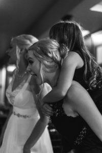 Bridesmaid and flowergirl having fun at wedding
