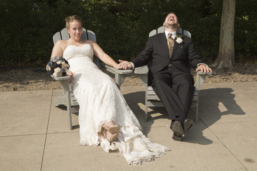 bride and groom in lounge chairs