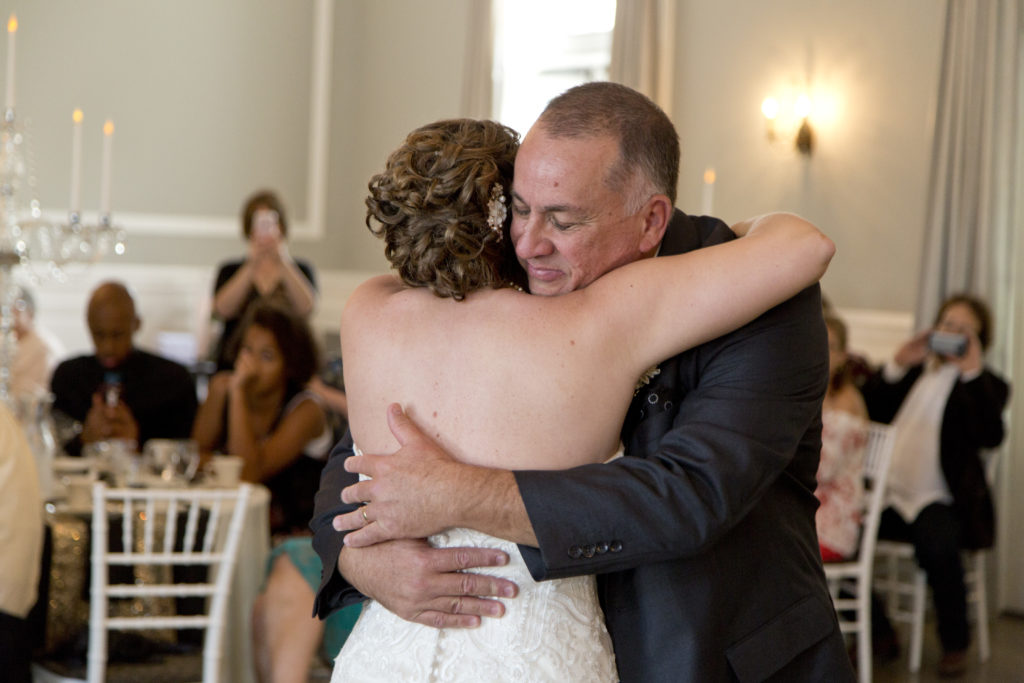 bride and dad hugging cleveland wedding planner