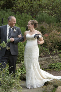 bride and dad smiling at each other