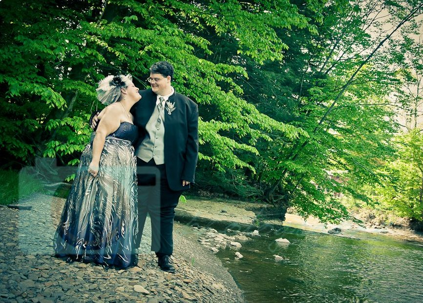 Bride and grrom by river
