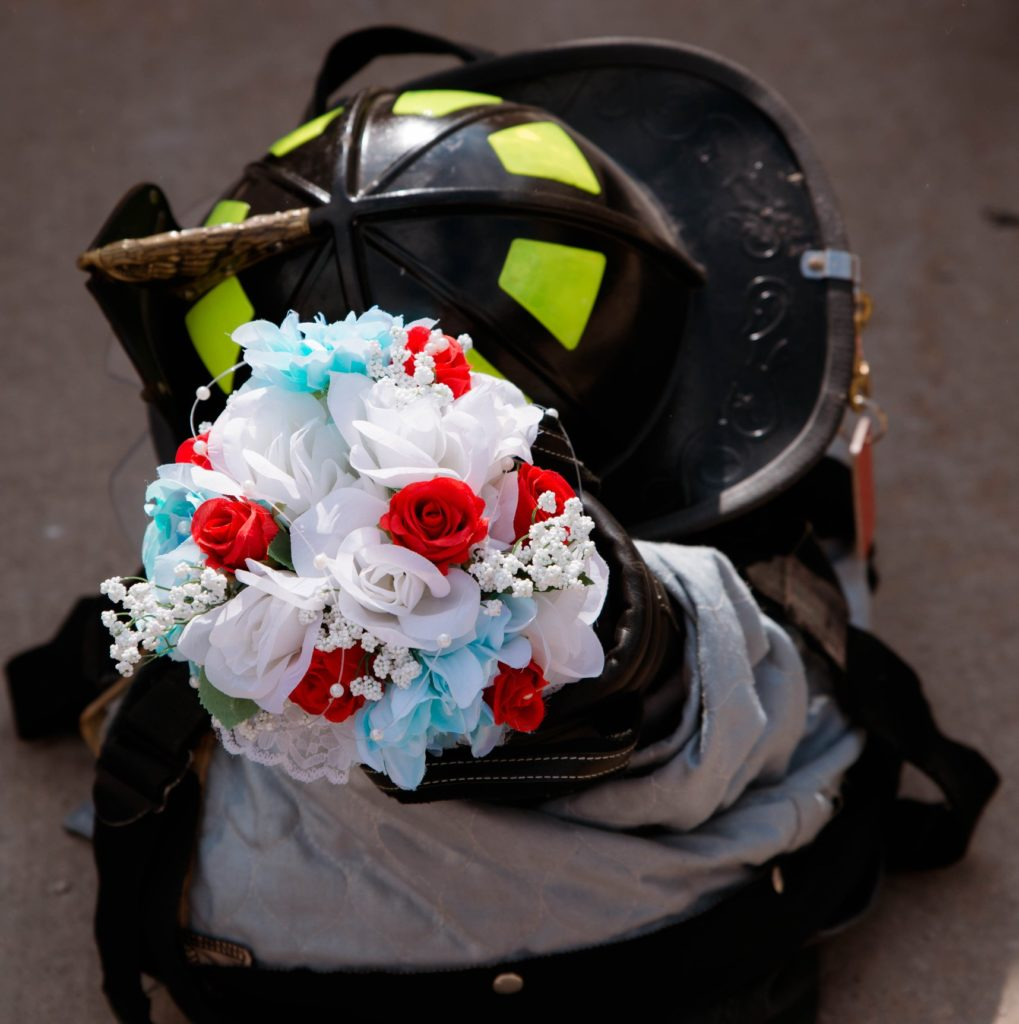Cleveland wedding planner firefighter helmet and flowers