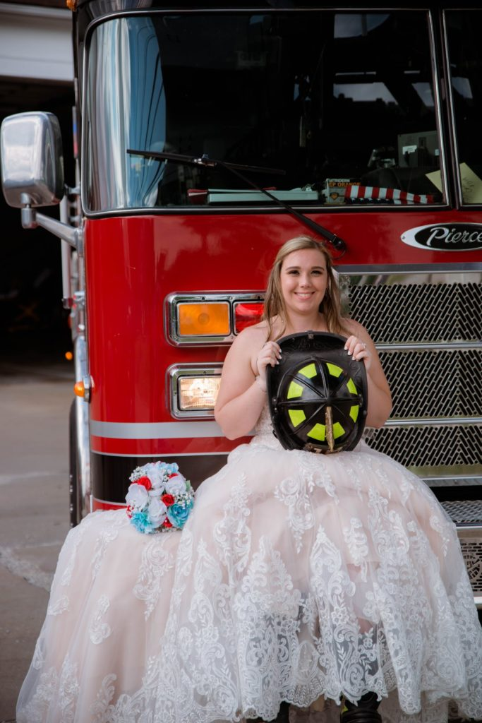 Cleveland wedding planner bride on firetruck
